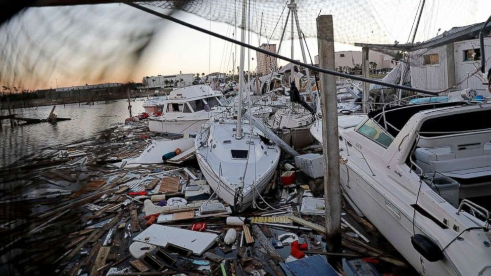 Damaged boats sit among debris in a marina in the aftermath of Hurricane Michael in Panama City, Fla., Oct. 12, 2018.