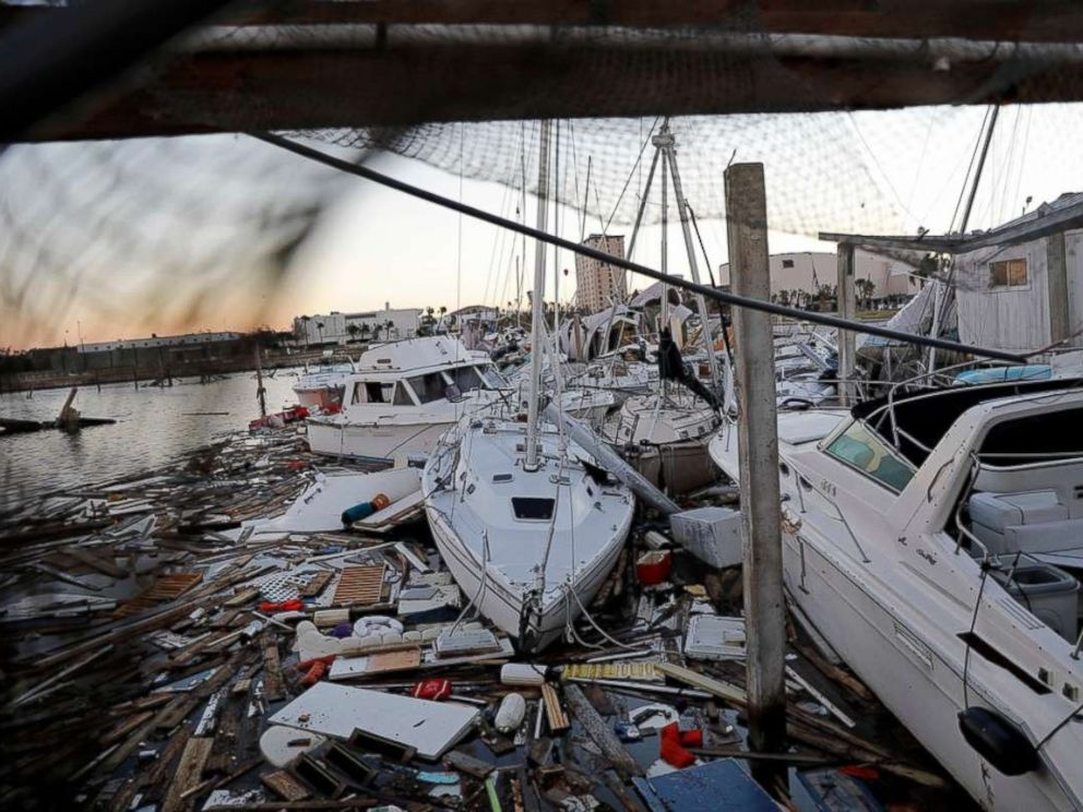 PHOTO: Damaged boats sit among debris in a marina in the aftermath of Hurricane Michael in Panama City, Fla., Oct. 12, 2018.