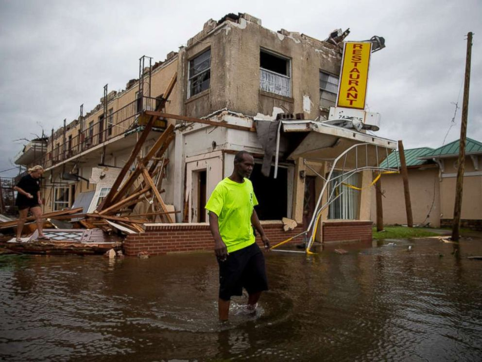 PHOTO: A man walks near a damaged apartment building following Hurricane Michael in Panama City, Fla., Oct. 10, 2018. Hurricane Michael charged through Florida and into Georgia on Wednesday, lashing the Panhandle with rains and heavy winds.