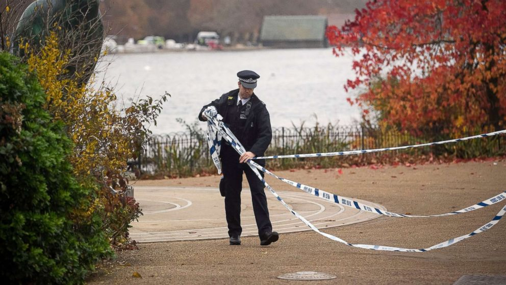 Police set up a cordon around the Serpentine Lake in Hyde Park in London following reports of the discovery of an object that could be unexploded ordnance, Nov. 16, 2018.