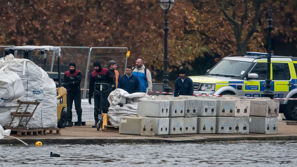 A police dive team works at the scene at the Serpentine Lake in Hyde Park in London following reports of the discovery of an object that could be unexploded ordnance, Nov. 16, 2018.