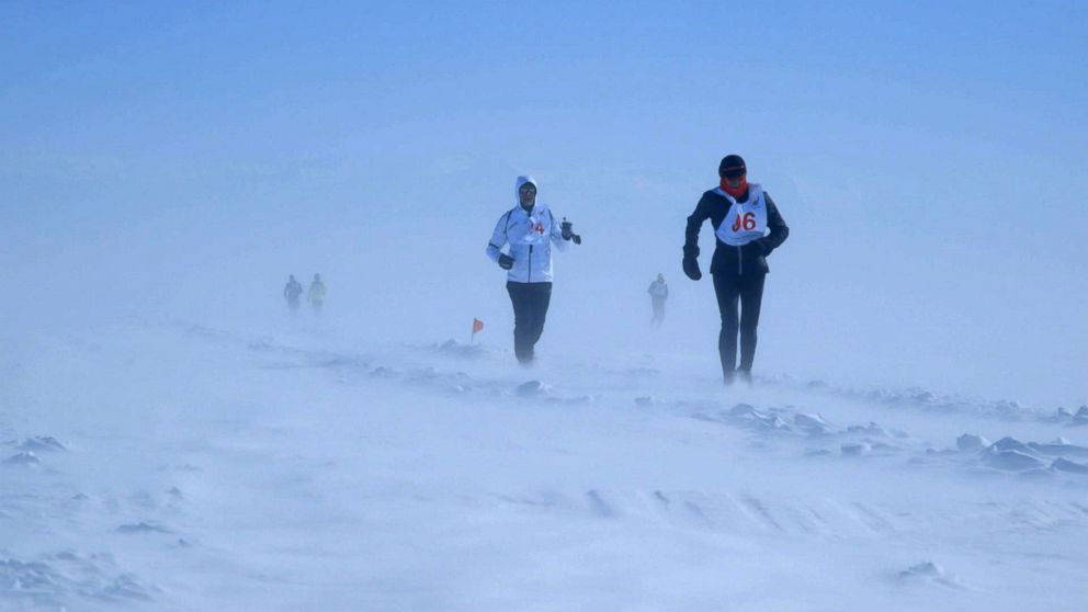 PHOTO: Runners run through blizzard conditions during the Baikal Ice Marathon in Siberia.