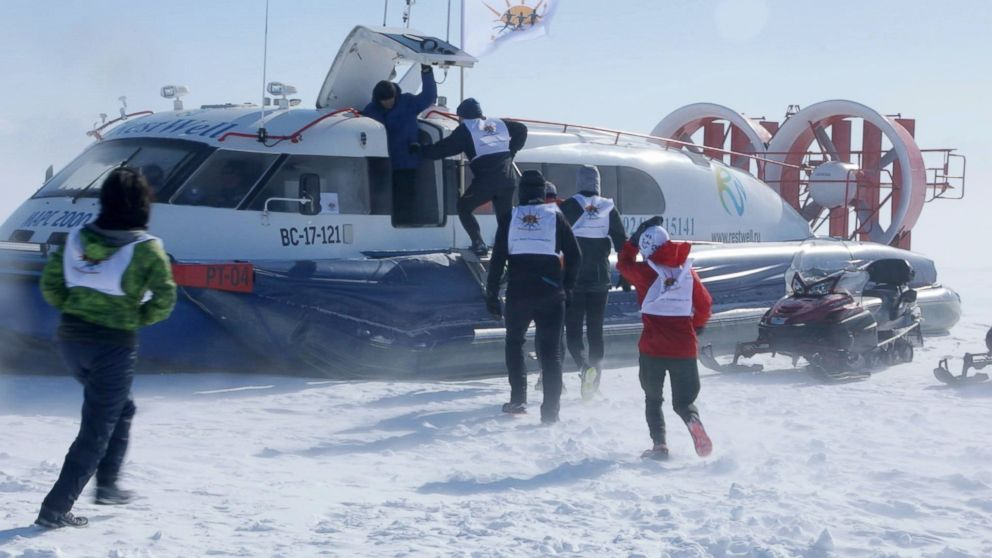 PHOTO: Runners are evacuated via hovercraft after the Baikal Ice Marathon was postponed due to inclement weather.
