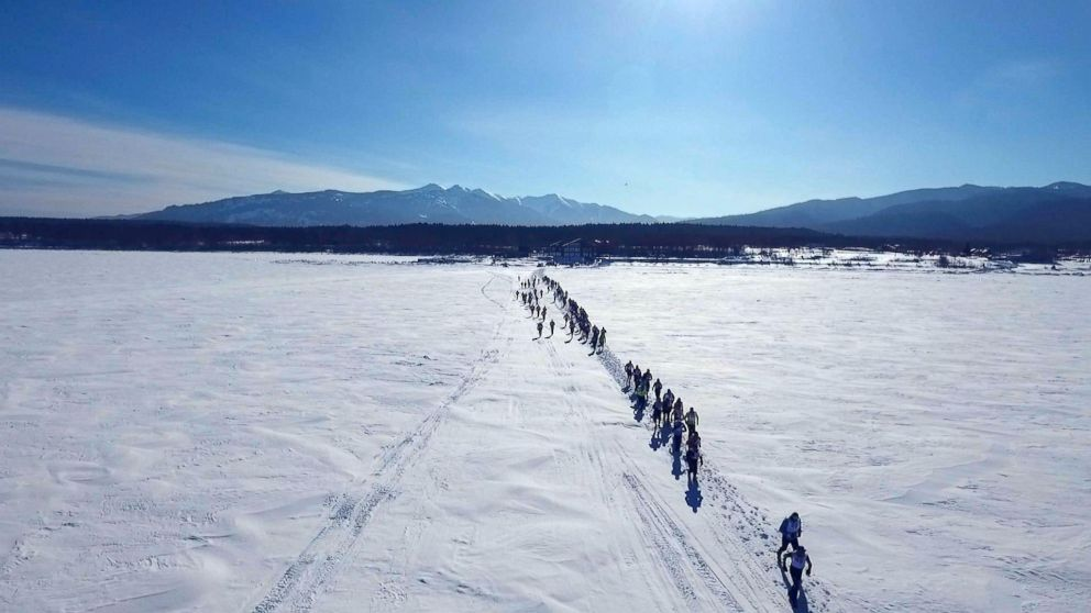 Runners just after the start of the Baikal Ice Marathon on Lake Baikal, the deepest lake in the world.