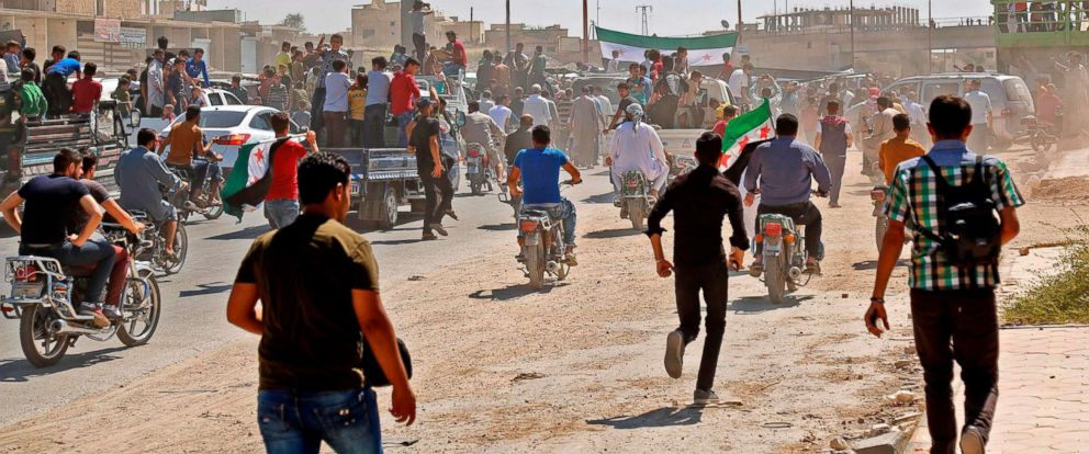 PHOTO: Syrians chant slogans and wave flags of the opposition as they protest against the regime and its ally Russia, in the rebel-held town of Maarrat al-Numan in the north of Idlib province on Aug. 31, 2018.