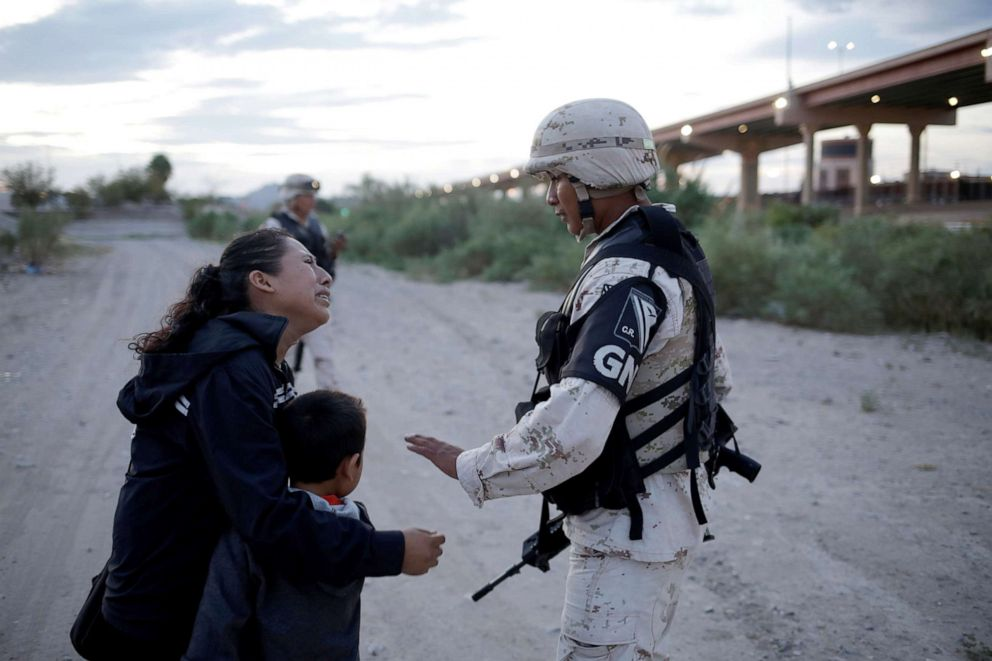 PHOTO: Guatemalan migrant Lety Perez embraces her son Anthony while asking a member of the Mexican National Guard to let them cross into the United States, as seen from Ciudad Juarez, Mexico July 22, 2019.