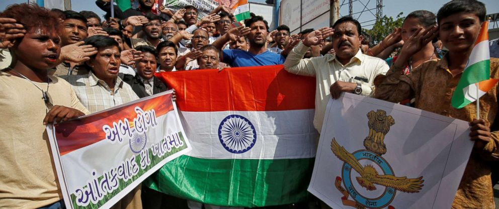 PHOTO: People holding national flags and an Indian Air Force flag salute to celebrate Indian airstrikes on militant camps in Pakistani territory, Feb. 26, 2019, in Ahmedabad, India.