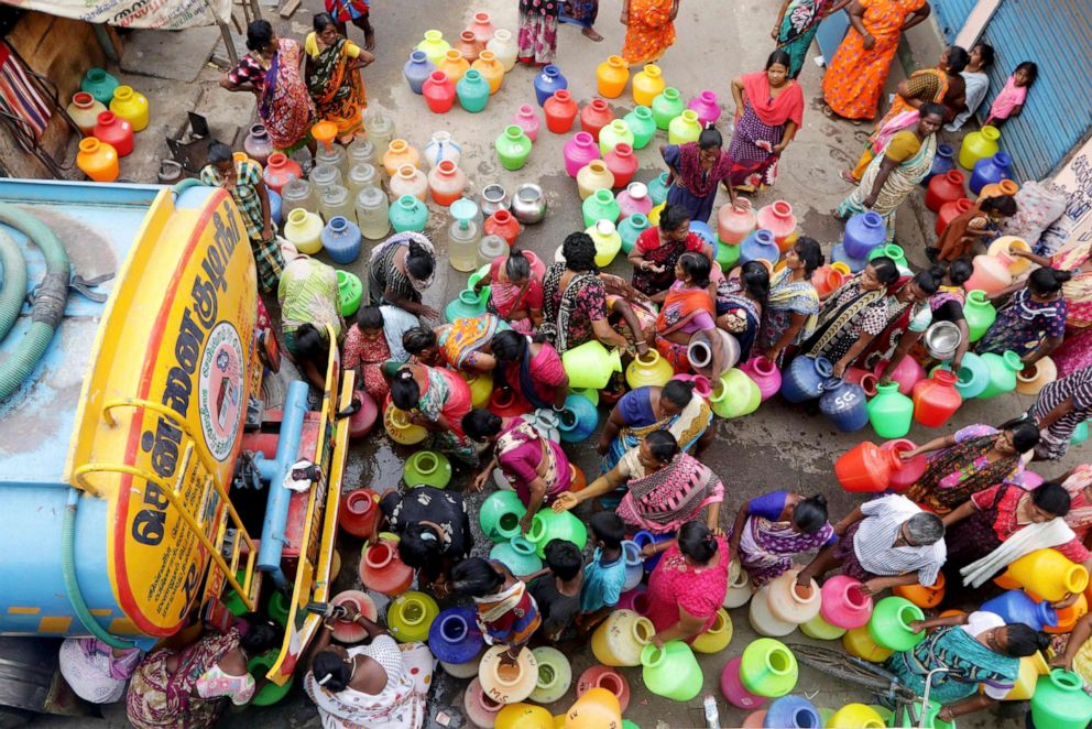 PHOTO: In this June 19, 2019, file photo, Indians stand in queues to fill vessels filled with drinking water from a water tanker in Chennai, capital of the southern Indian state of Tamil Nadu.