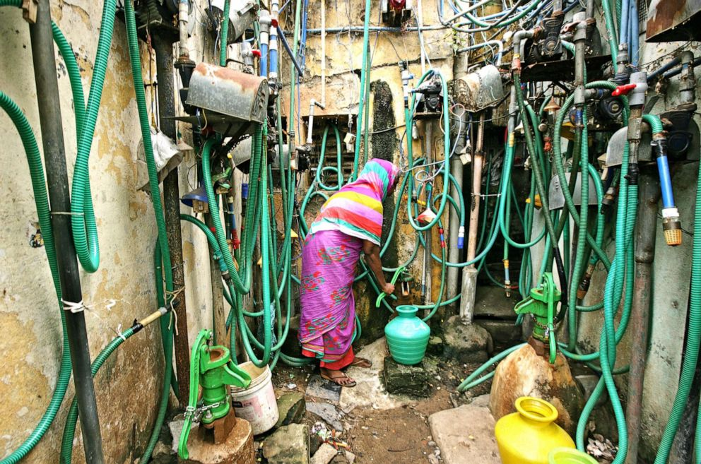 PHOTO: A woman uses a hand pump to fill up a container with drinking water in Chennai, India, June 25, 2019.