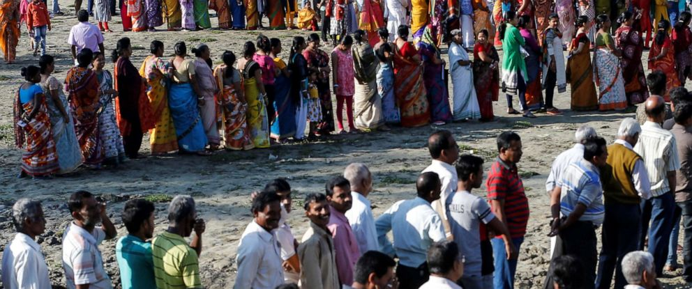 PHOTO: Voters line up to cast their votes outside a polling station during the first phase of general election in Alipurduar district in the eastern state of West Bengal, India, April 11, 2019.