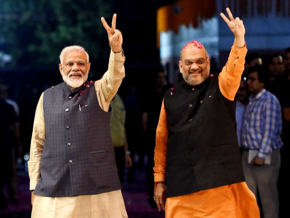 PHOTO: Indian Prime Minister Narendra Modi (left) and president of the ruling Bharatiya Janata Party (BJP) Amit Shah gesture as they celebrate the victory in Indias general elections, in New Delhi on May 23, 2019.