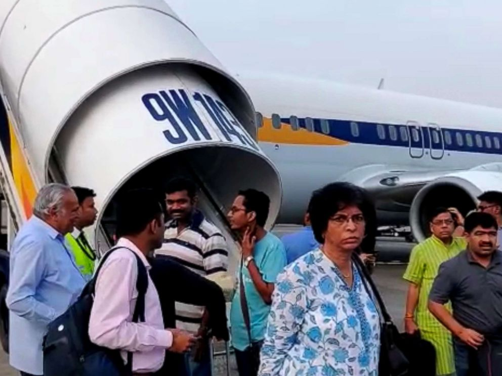 PHOTO: Passengers stand on the tarmac after an emergency landing, due to lost cabin pressure, on a Jet Airways flight, in Mumbai, India, Sept. 20, 2018 in this still image obtained from social media video.