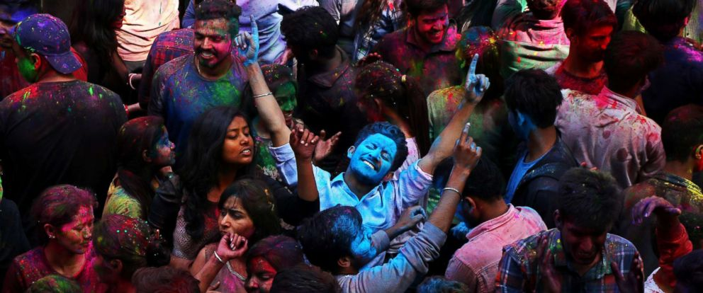 PHOTO: Students with their faces smeared in colored powder dance as they celebrate the Hindu festival of Holi, heralding Spring, at a university campus in Chandigarh, India on March 1, 2018.
