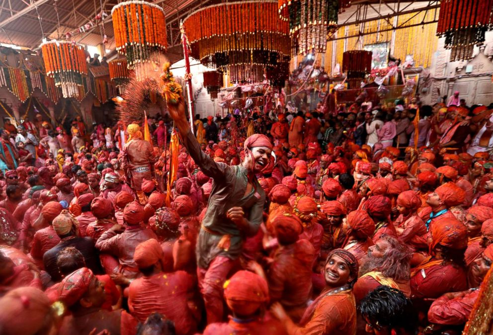 PHOTO: Hindu men from the villages of Nandgaon and Barsana celebrate the Lathmar Holi festival at the Radha Rani temple in Barsana village, Mathura, India, Feb. 24, 2018.