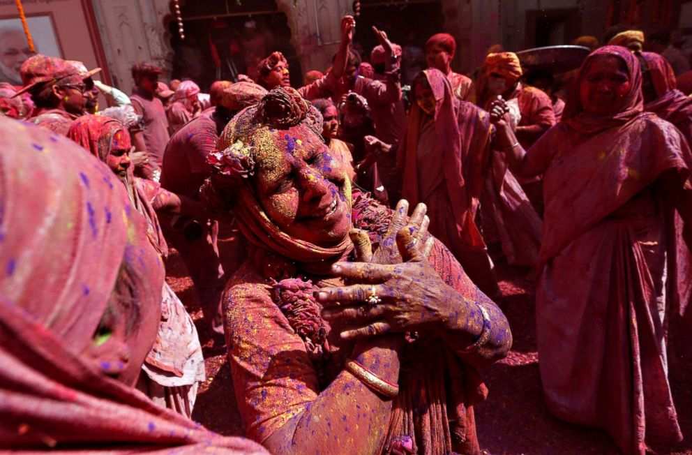 PHOTO: Widows covered in colors dance during Holi celebrations in the town of Vrindavan in the northern state of Uttar Pradesh, India, Feb. 27, 2018.
