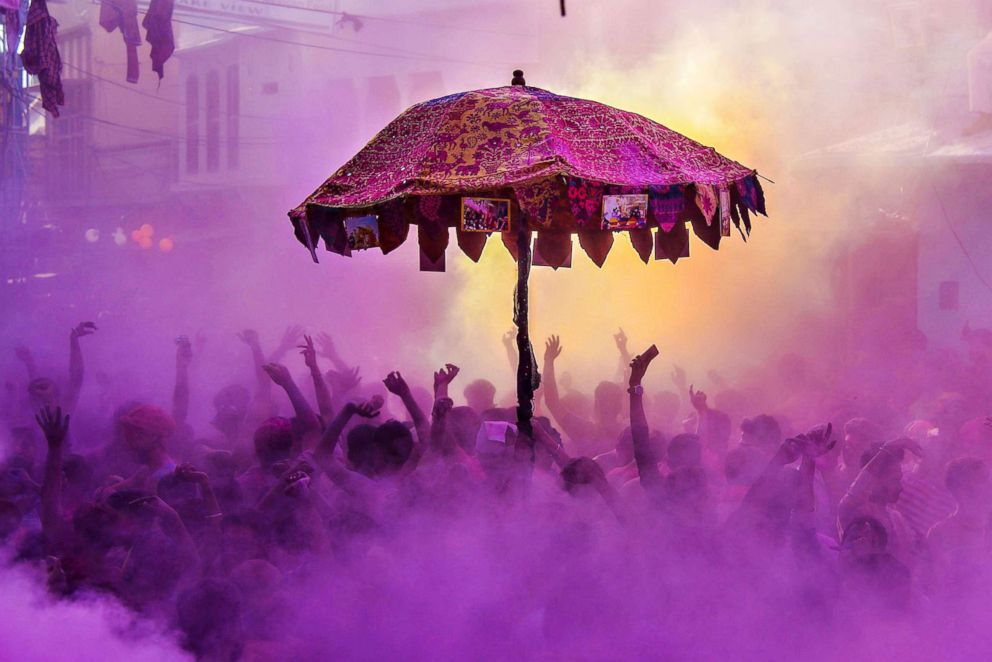 PHOTO: Indian and foreign tourists take part in the kapda phaar or cloth tearing during Holi celebrations in Pushkar, in the Indian state of Rajasthan on March 2, 2018.