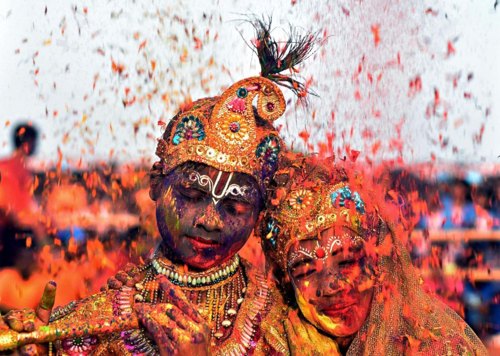 PHOTO: Tribal students from the Kalinga Institute of Social Science (KISS), dressed as Lord Krishna and Radha, face a rain of petals during Holi celebrations in the city of Bhubaneswar in Odisha, India on March 1, 2018.