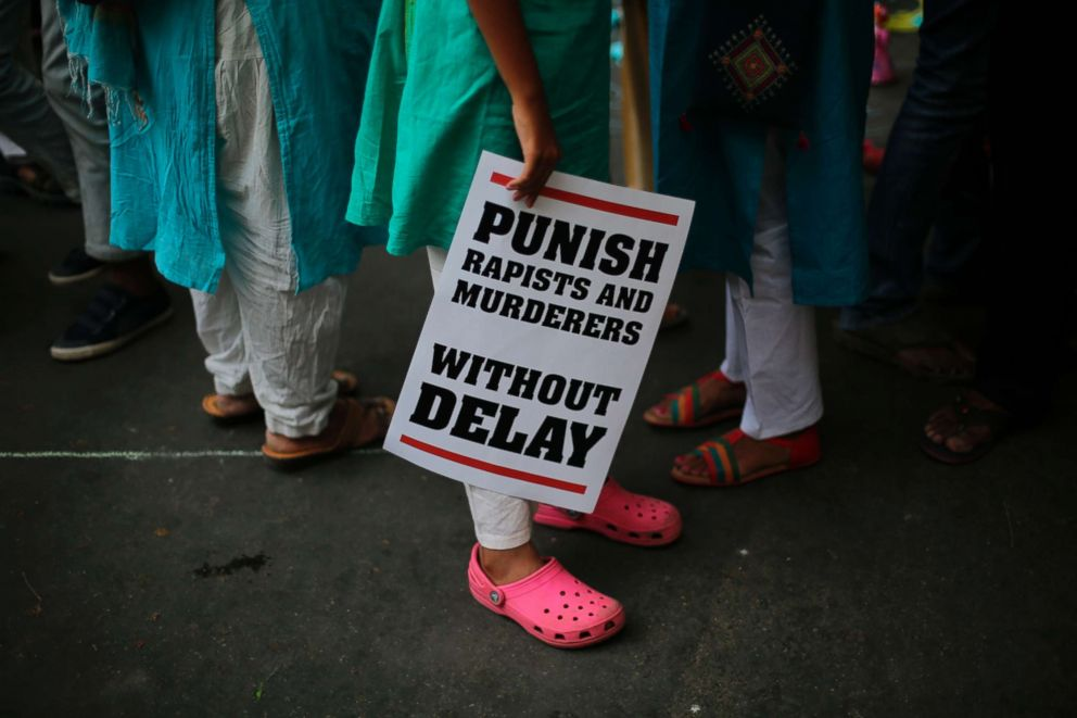PHOTO: Indian demonstrators display placards during a protest against two recently reported rape cases as they gather near the Parliament in New Delhi, India, April 15, 2018.