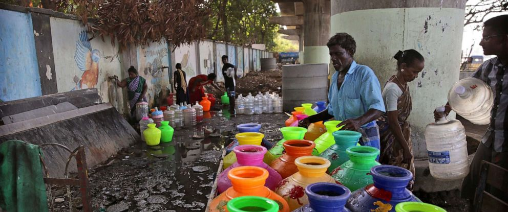 PHOTO: In this Monday, July 15, 2019, photo, Indians fill drinking water at a water filling depot in Chennai, capital of the southern Indian state of Tamil Nadu.