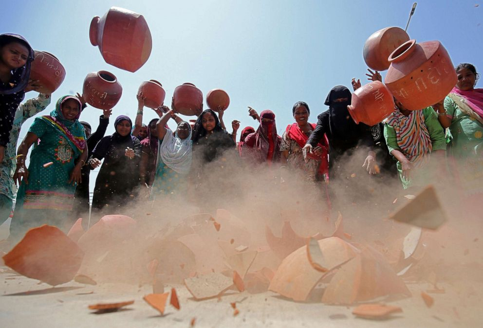 PHOTO: Women throw earthen pitchers onto the ground in protest against the shortage of drinking water outside the municipal corporation office in Ahmedabad, India, May 16, 2019.