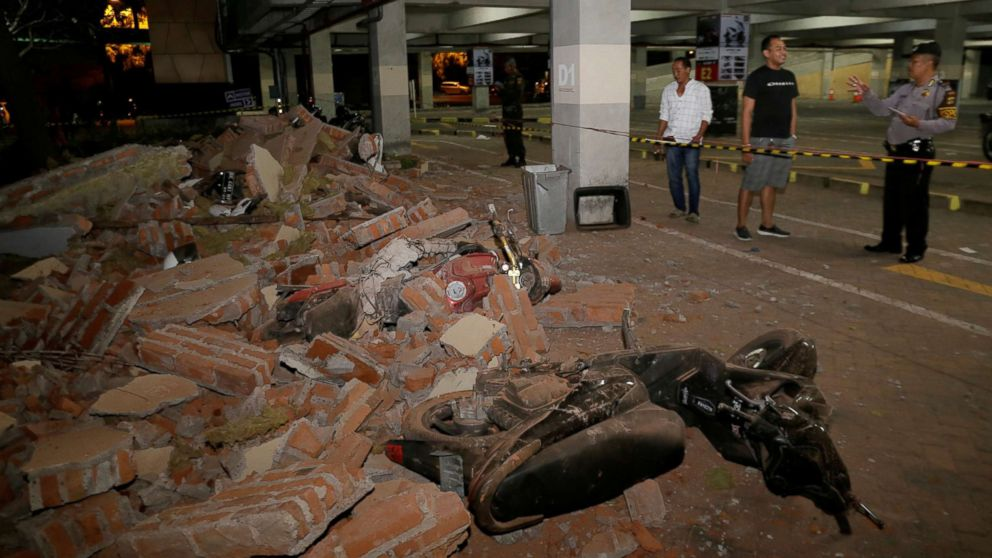 A policeman examines debris that fell and crushed parked motorbikes following a strong earthquake on nearby Lombok island, at a shopping center in Kuta, Bali, Indonesia, Aug. 5, 2018.