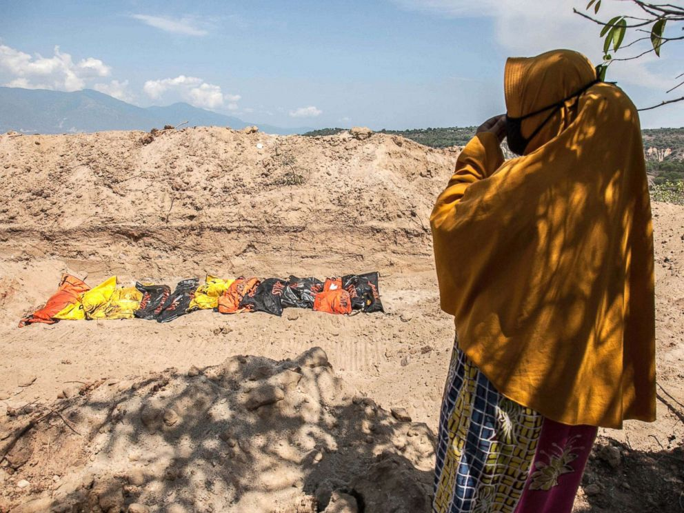 PHOTO: Susanti, stands near a mass burial field where her husband was buried, Oct. 3, 2018, after a earthquake and tsunami hit Palu, Central Sulawesi, Indonesia on Sept. 28.