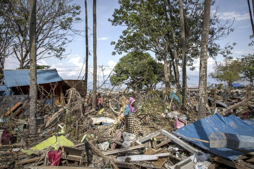 PHOTO: An elderly women, Riba, walks through the rubble and debris of building that was destroyed by a tsunami, Oct. 03, 2018, in Donggala, Central Sulawesi, Indonesia.