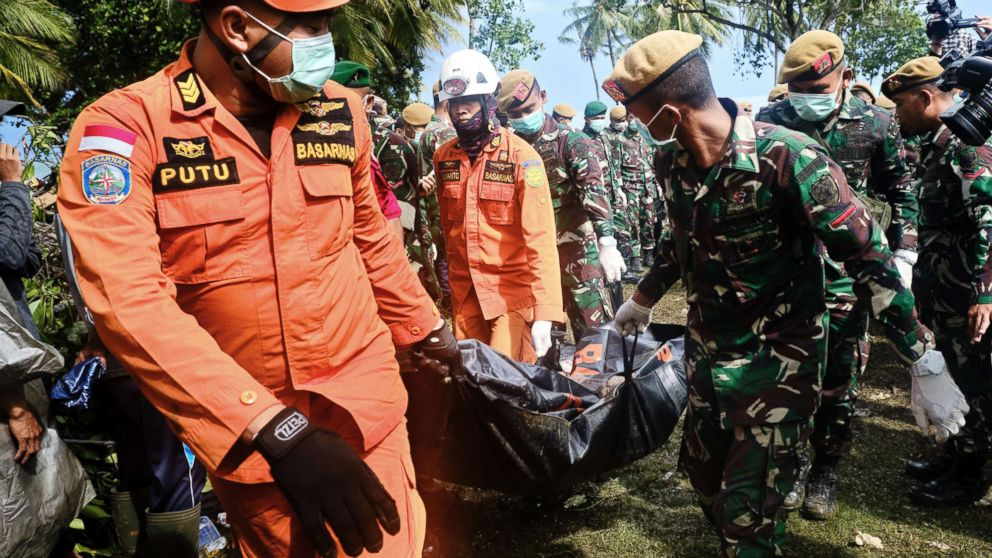 Rescue workers recover the body of a victim of the tsunami during a search at a resort hotel on in Tanjung Lesung, Indonesia, Dec. 24, 2018.