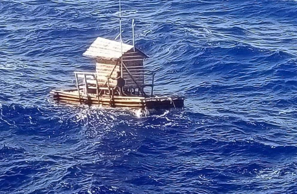 Consulate General in Osaka 18-year-old Aldi Novel Adilang is seen on a wooden fish trap floating in the waters near the island of Guam