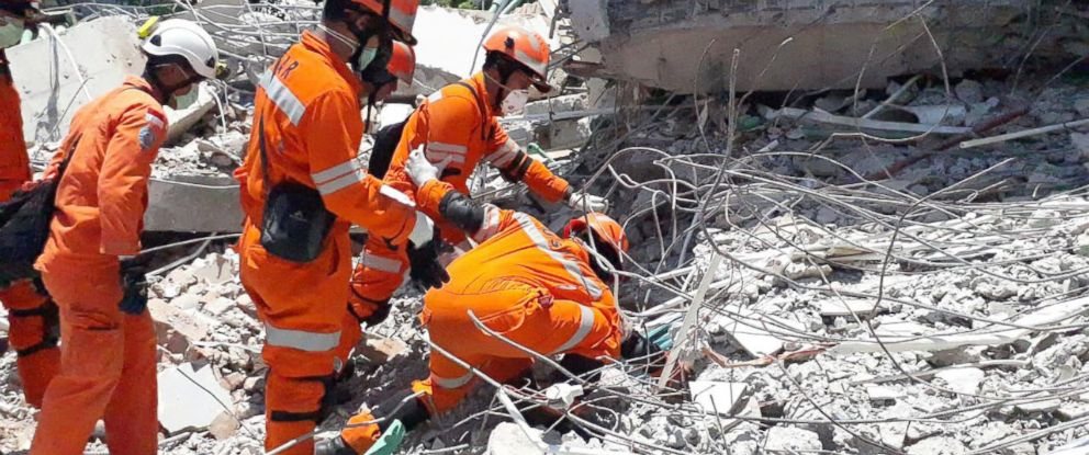 PHOTO: A handout photo made available by the Indonesian National Search and Rescue Agency (BASARNAS) shows rescuers search for victims after a 7.7 magnitude earthquake and tsunami in Palu, Central Sulawesi, Indonesia, Oct. 1, 2018.