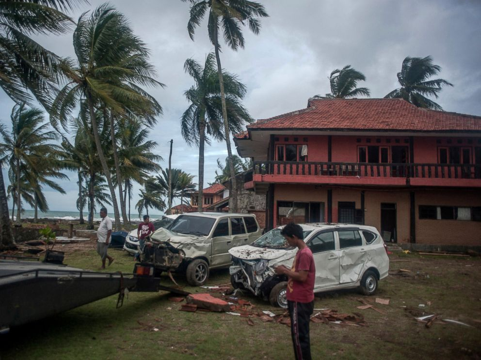 PHOTO: Owners reclaim their damaged cars from a resort affected by Saturdays tsunami in Carita, Indonesia, Tuesday, Dec. 25, 2018.