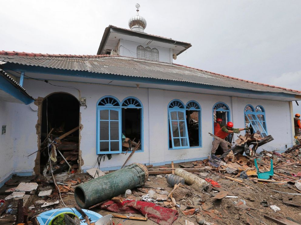 PHOTO: People clean up a mosque following the tsunami in Sumur, Indonesia, Tuesday, Dec. 25, 2018.