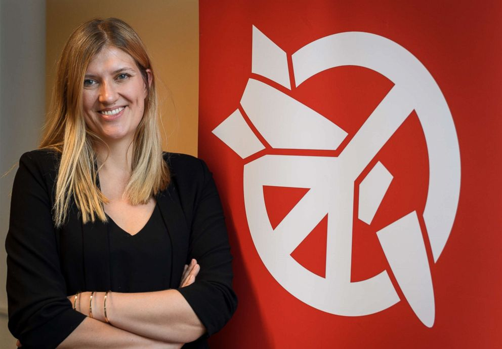 PHOTO: Beatrice Fihn, executive director of 2017 Nobel Peace Prize-winning International Campaign to Abolish Nuclear Weapons (ICAN), poses next to the ICAN logo at their headquarters, Nov. 30, 2017, in Geneva.