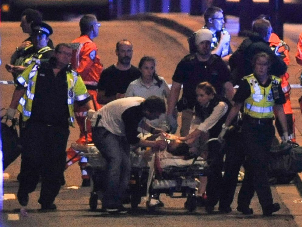 PHOTO: Police and members of the emergency services attend to victims of a terror attack on London Bridge in central London on June 3, 2017.