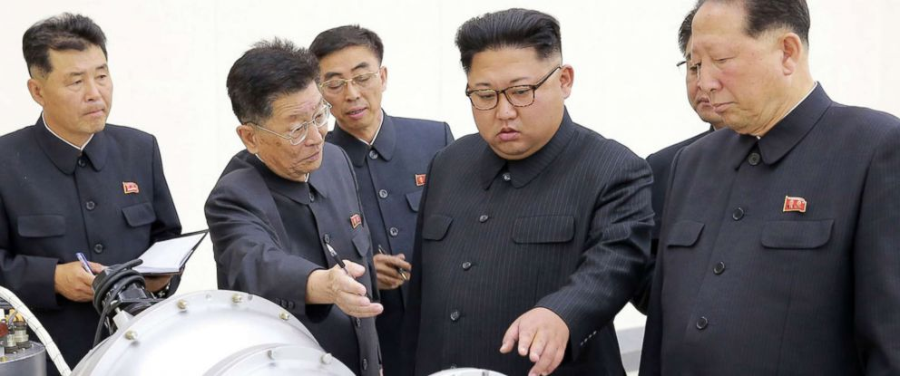 PHOTO: This undated picture released by North Koreas official Korean Central News Agency (KCNA) on September 3, 2017 shows North Korean leader Kim Jong-Un, center,looking at a metal casing with two bulges at an undisclosed location.