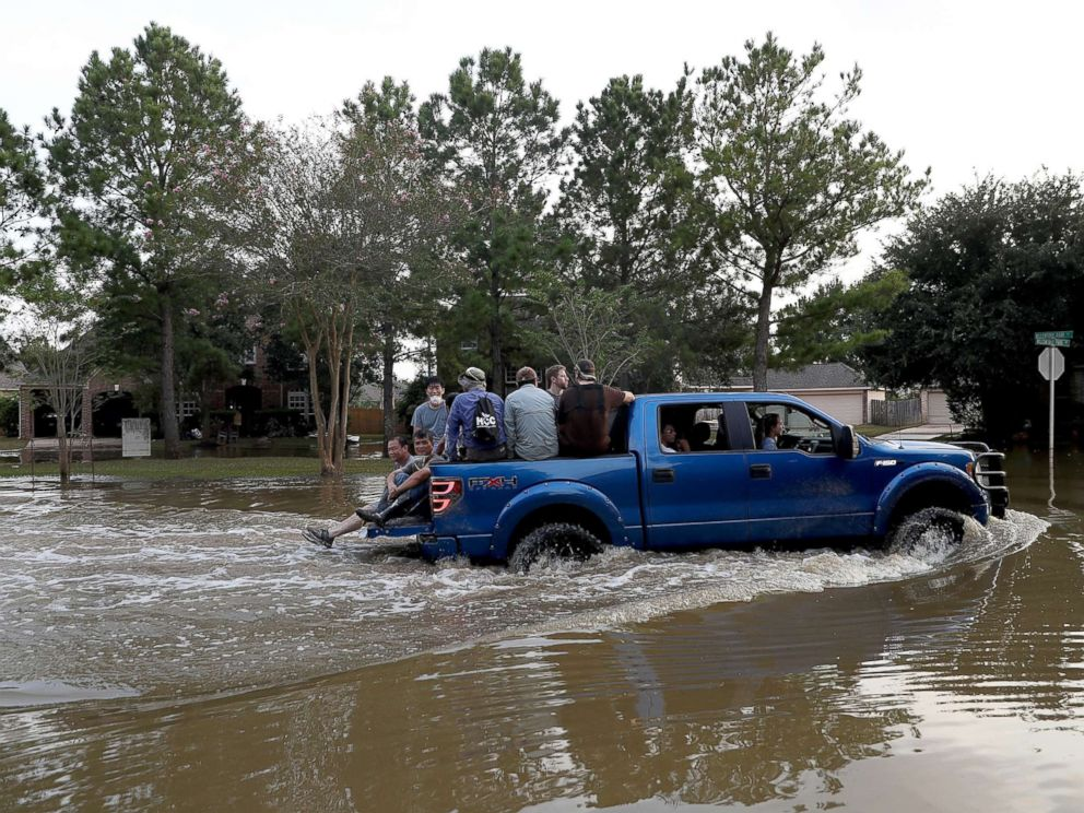 PHOTO:People ride through floodwaters,caused by Hurricane Harvey, in a four wheel drive truck on September 4, 2017 in Katy, Texas. A week after it hit Southern Texas, residents are beginning the long process of recovering from the storm.