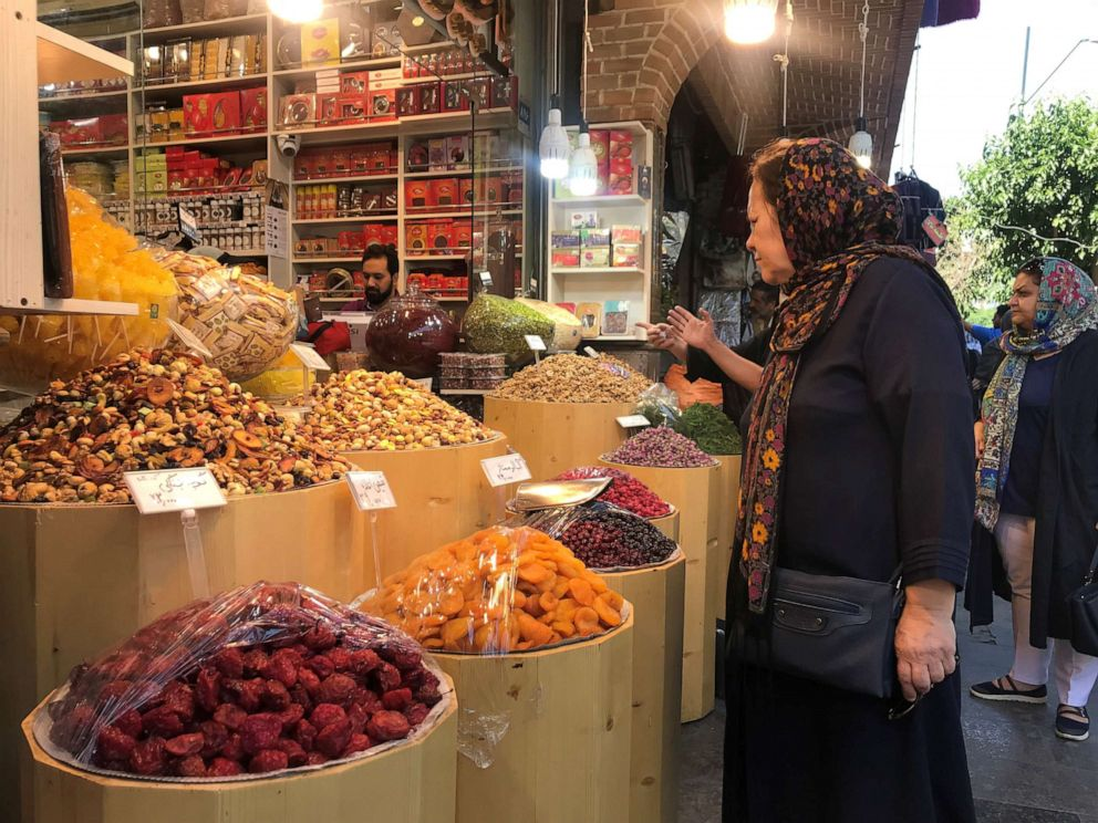 PHOTO: An Iranian woman expresses surprise at the high prices in the Grand Bazaar, in Tehran, Iran, on June 1, 2019.