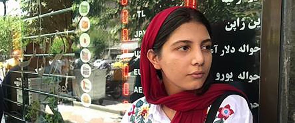 PHOTO: Nafas Anvari, 26, waits at the door of a currency exchange shop, Tehran, Iran, June 15, 2019.