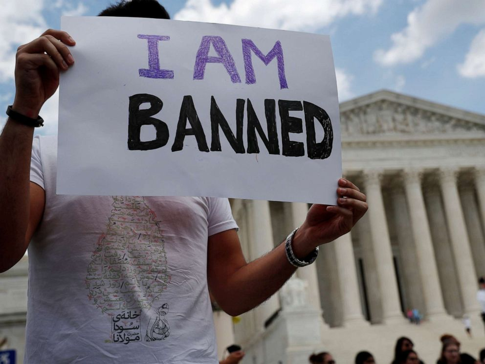 PHOTO: Mehrad Ansari of Iran holds a sign outside of the U.S. Supreme Court after U.S. President Trumps travel ban was upheld in Washington, D.C., June 26, 2018.