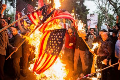 PHOTO: Iranians burn American flags during an anti-U.S. demonstration outside the former U.S. embassy headquarters in Tehran, Iran, on May 9, 2018.