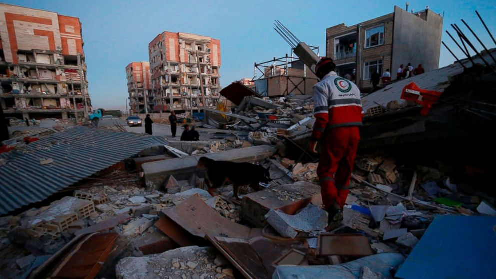 Rescue personnel conduct search and rescue work following a 7.3-magnitude earthquake at Sarpol-e Zahab in Iran's Kermanshah province, Nov. 13, 2017.