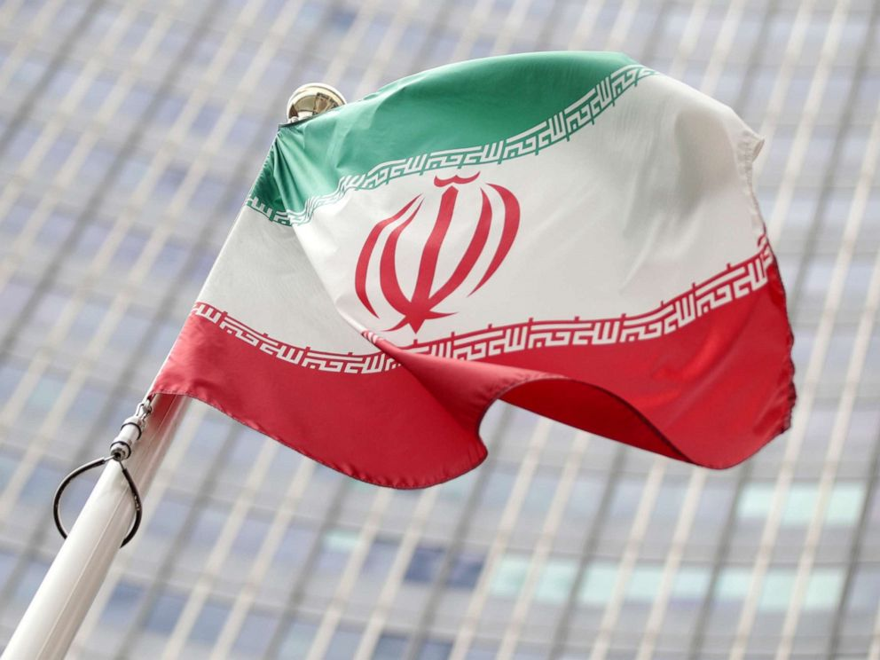 PHOTO: The Iranian flag flutters in front the International Atomic Energy Agency (IAEA) headquarters in Vienna, Austria, on Wednesday, July 10, 2019.