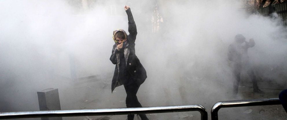 PHOTO: A university student attends a protest inside Tehran University as a smoke grenade is thrown by anti-riot Iranian police, in Tehran, Iran, Dec. 30, 2017, in a photo obtained by the AP.