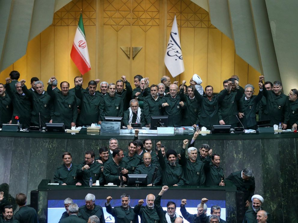 PHOTO: Wearing the uniform of the Iranian Revolutionary Guard, lawmakers chant slogans during an open session of parliament in Tehran, Iran, Tuesday, April 9, 2019.