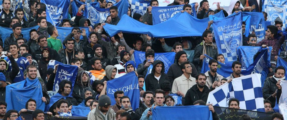 PHOTO: Supporters of Iranian soccer team Esteghlal, hold flags of their favorite team, at the Azadi stadium, in Tehran, Iran, Dec. 9, 2011.