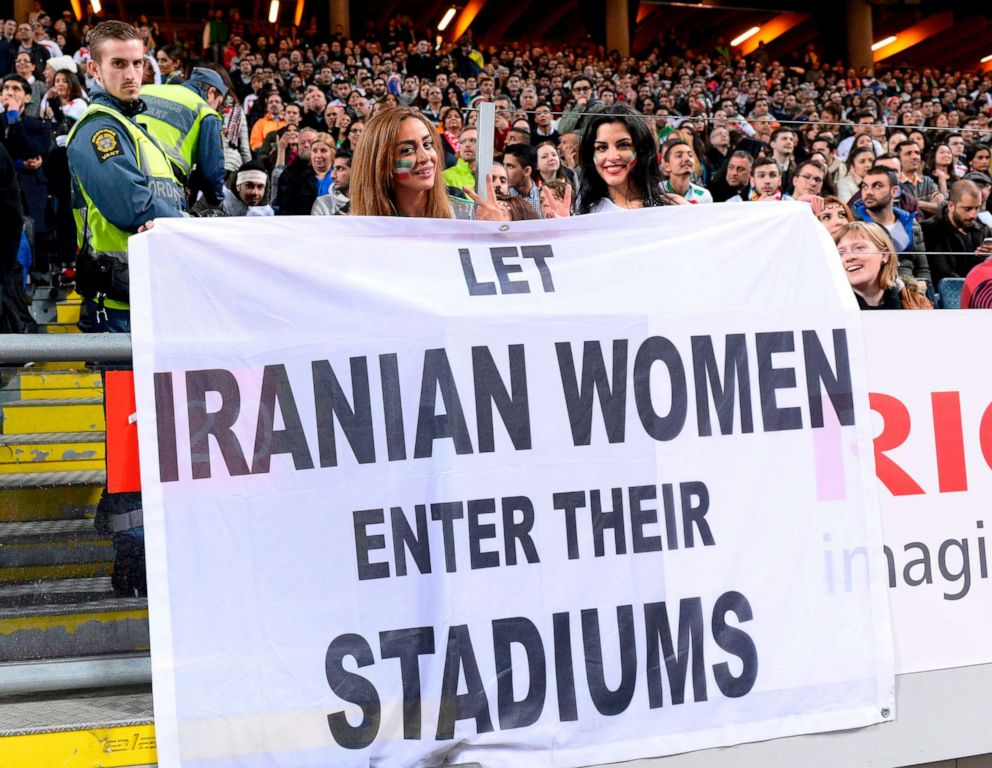 PHOTO: Supporters hold a banner reading Let Iranian women enter their stadiums during the friendly international match between Sweden and Iran at the Friends Arena near Stockholm.