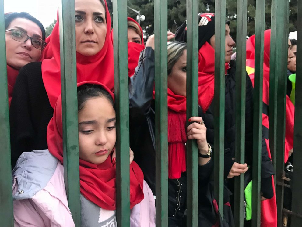 PHOTO: Iranian women wait behind the gates of Tehrans Azadi Stadium trying to convince security officers to let them in, Nov. 10, 2018.