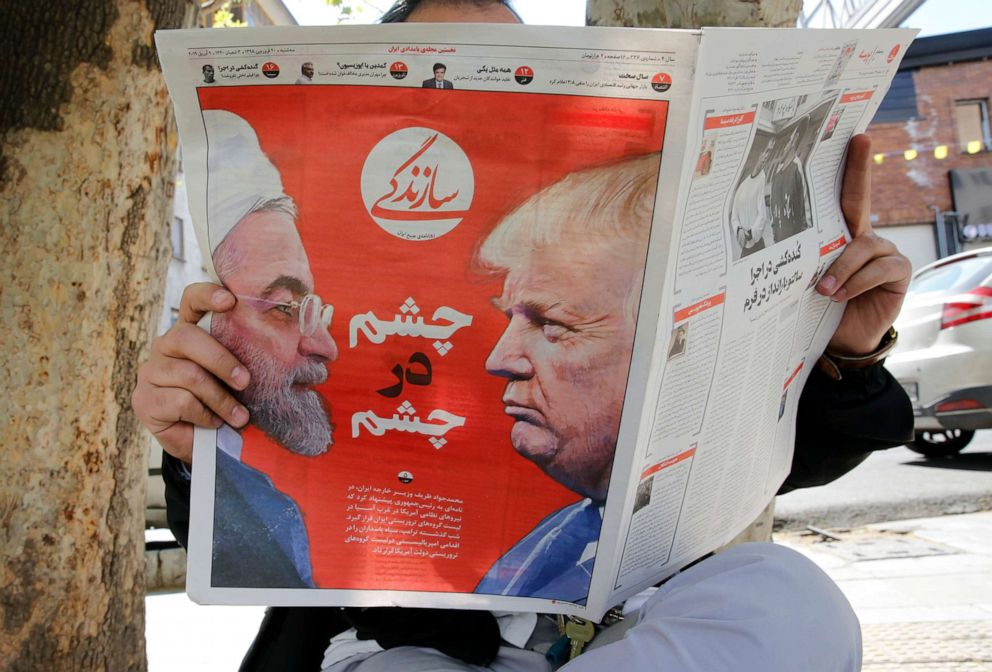 PHOTO: An Iranian man reads the Iranian daily newspaper Sazandegi with a pictures of Iranian president Hassan Rouhani and President Donald Trump on its front page next to a kiosk in Tehran, Iran, April 9, 2019.