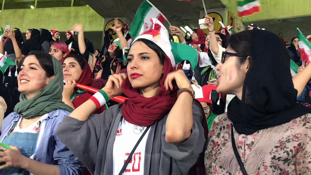 PHOTO: Zahra Ahooei, 30, center, watches the World Cup qualifying match between Iran and Cambodia at Azadi Stadium in Tehran, Iran, Oct. 10, 2019.
