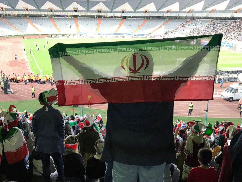PHOTO: A woman holds the Iranian flag in the stands during the World Cup qualifying match between Iran and Cambodia at Azadi Stadium in Tehran, Iran, Oct. 10, 2019.